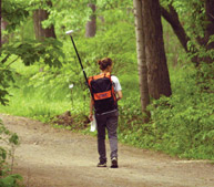 A student uses a Global Positioning System in the Morgan Arboretum.