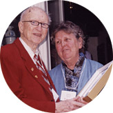 Russ Merifield, BA'38, BCL'40, is presented with the Outstanding Alumnus Award by Andrea Alexander, BPE'60, honorary president of the Toronto branch and last year's recipient of the award.