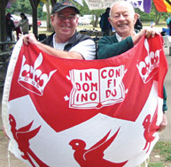The Victoria branch of the Alumni Association joined in the annual Canadian University Alumni Picnic in July. Hoisting the McGill flag are branch president Tim Houlihan, MUP'76, and David Rodger, MDCM'35.