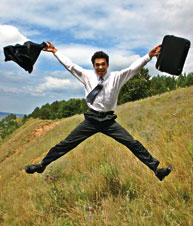 Man in suit jumping for joy.